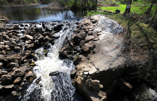 Byfield: The Parker River near the fish ladder on Central Street in Byfield goes over the dam in a trickle due to the recent lack of rain. Jim Vaiknoras/staff photo