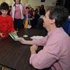 Newburyport: Duncan Dener, 8, gets a book signed by Jeff Kinney, author of Diary of a Whimp Kid, in the gym an the Immaculate Conception School as part of the annual Newburyport Literary Festival Saturday. JIm Vaiknoras/staff photo