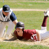 Newburyport: Newburyport's Evan Habib slides safely back to first just under the tag of Paul DeMarino during the Clippers home opener against Hamilton-Wenham Saturday the Lower Field in Newburyport. JIm Vaiknoras/staff photo