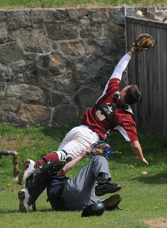 Newburyport: Newburyport'sJimmy Conway tries to make a play on a foul ball as he gets tangled up with Umpire John Prisco of Wakefield during the Clippers home game against Amesbury Saturday. Jim Vaiknoras/Staff photo