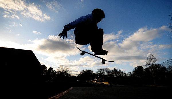 Newburyport: Matthew Reeves, 9, of Newburyport catches some air while skate boarding with his brother Jack, in the late afternoon at the Nock Middle School