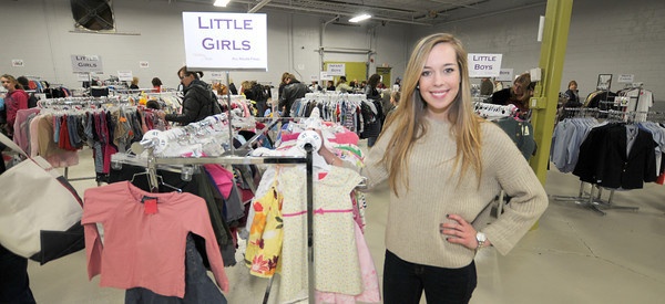 Newburyport: Lauren Sundstrom at the Clothes for Hope clothing sale on Milikan Way in Newburyport Saturday. The event raised money for New Seed International and the children of teh Keta School District in Ghana. jim vaiknoras/staff photo