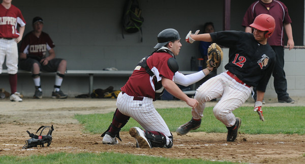Newburyport: Newburyport's Jimmy Conwaywaits for the ball as Amesbury Noah Klingerman slide safely home during the Clippers home game against Amesbury Saturday. Jim Vaiknoras/Staff photo