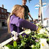 Newburyport: Andy Hoffmeier and his daughter Allison, 7, plant flowers in window boxes along State Street in Newburyport Friday afternoon. Andy works for Greenskeepers the company that takes care of the plants in the city. Jim Vaiknoras/staff photo