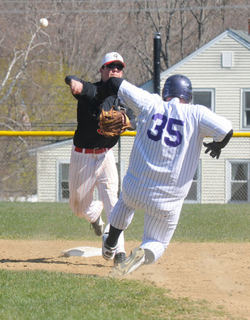 Amesbury: Tommy Connors turns a double play during the Indians game against Shawsheen Saturday in Amesbury. Jim Vaiknoras/staff photo