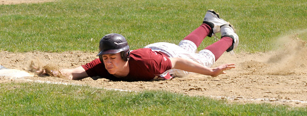 Newburyport: Newburyport's Evan Habib slides safely back to first during the Clippers home opener against Hamilton-Wenham Saturday the Lower Field in Newburyport. JIm Vaiknoras/staff photo