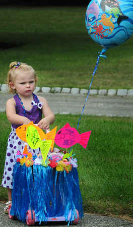Newburyport: A serious looking Lillian McCarthy, 22 months, of Amesbury, dressed in an ocean theme,  checks out the other carriages for the parade at Kids Day in the Park.