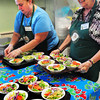 Amesbury: Our Neighbor's Table volunteers Betty Vitale, left, of Amesbury prepares salads as Betty Elliott of Merrimac takes them to guests in the dining room. The organization is celebrating its 20th anniversary.Bryan Eaton/Staff Photo