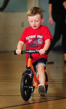 Newburyport: Tyler Bergeron, 3, pedals along with without real pedals on this balance bike in the Brown School gym on Wednesday morning. He was in the Newburyport Youth Services program Knucklebones which is for toddlers to interact with each other through educational and physical activities. Bryan Eaton/Staff Photo