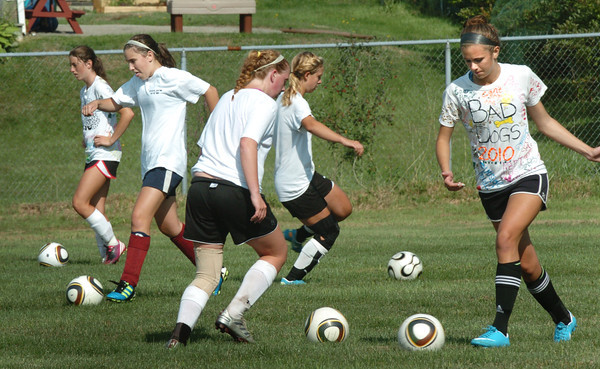 Newburyport: Newburyport High girls soccer team practices on Fuller Field yesterday. Bryan Eaton/Staff Photo