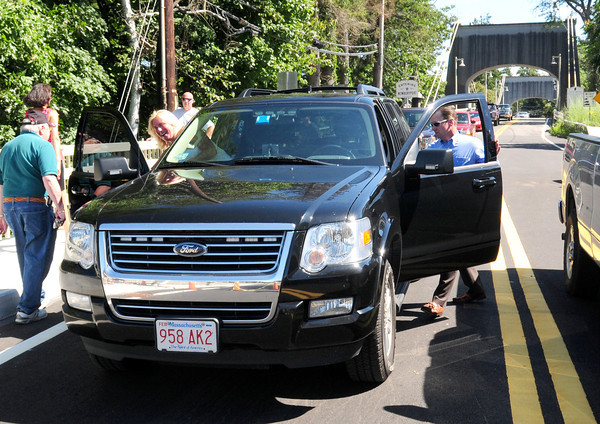 Amesbury: Sue and Steven Hines get into their vehicle to be the first to cross over the new First Lt. Derek Hines Memorial Bridge yesterday. The bridge was named in honor of their son who died in action in Afghanistan. Bryan Eaton/Staff Photo