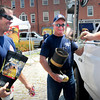 Newburyport: Newburyport firefighters Josh Mesina, left, and Randy Cookinham collect money for the Muscular Dystrophy Association with boots in Market Square yesterday. Earlier an older gentleman walked by, according to Mesina, and dropped in a $100 bill. Bryan Eaton/Staff Photo