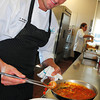 Salisbury: Seaglass chef Scott Brandolini plates Shrimp, Scallop and Mussel Pimenton. Bryan Eaton/Staff Photo