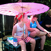 Newburyport: Maya Woundy, 4, left, and her cousin Samantha Ambrose, 7, both of Newburyport use parasol to keep in the shade while watching the parade. Bryan Eaton/Staff Photo