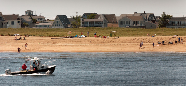 Plum Island: It's been a good week for sunbathers, here on Plum Island, and the weekend will be warm and humid with chance for shower, though Sunday the better day of the weekend. Bryan Eaton/Staff Photo