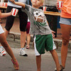 Newburyport: Jack Harden, 6, of Salisbury helps out with giving out water to runners in the Yankee Homecoming 10 Mile race. Bryan Eaton/Staff Photo