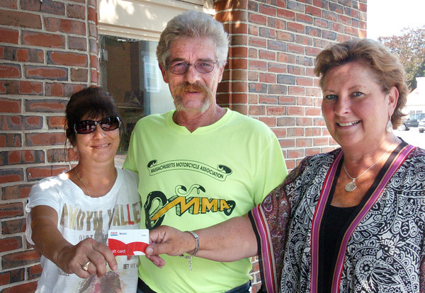 Newburyport: Daily News publisher Sheila Smith, right, presents Venetia and Fred Richard of Salisbury with their winning $500 gasoline card.