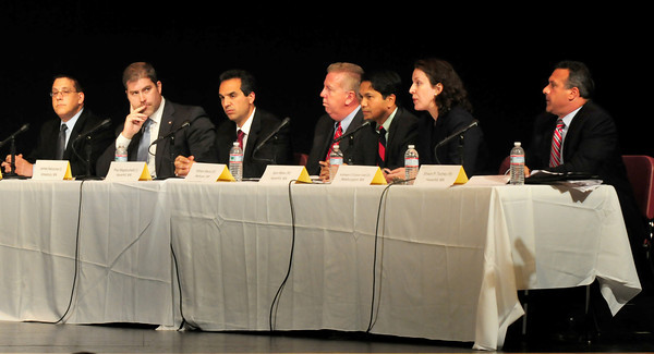 Newburyport: The seven people running for Steven Baddour's vacated state senate seat met in a debate yesterday afternoon at Amesbury High School. From left, Timothy Coco, James Kelcourse, Paul Magliocchetti, William Manzi, Sam Meas, Kathleen O'Connor Ives and Shaun P. Toohey. Bryan Eaton/Staff Photo