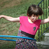 Amesbury: Elizabeth Ashkanazi, 4, tries to keep her hula hoop from hitting the ground, though it took the beginner several tries.  She was at the town's summer camp at Amesbury Town Park on Tuesday. Bryan Eaton/Staff Photo