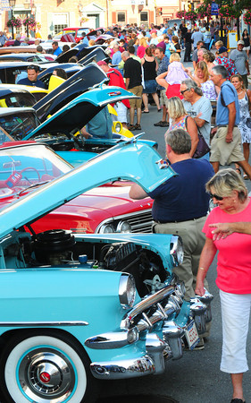Newburyport: Hundreds of people showed up the Cruisin the 50's show in downtown Newburyport last night. Antique cars from all over New England lined State, Pleasant in Inn Streets. Bryan Eaton/Staff Photo