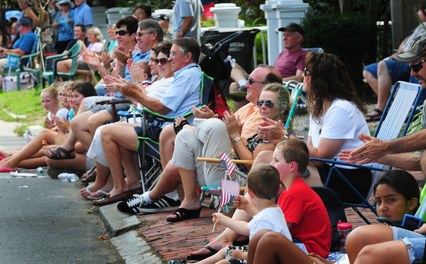 Newburyport: People cheer participants of the Yankee Homecoming Parade yesterday afternoon. Bryan Eaton/Staff Photo