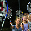 Newburyport: Youngsters take queues from counselors as they learn the basics of tennis on Wednesday morning. They were taking lessons through Newburyport Youth Services at Atkinson Common. Bryan Eaton/Staff Photo