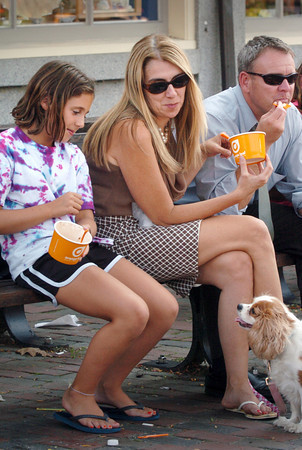 Newburyport: Family pooch Sara looks for her share of frozen yogurt in Market Square yesterday afternoon. Her family members from left, Ashley Smith, 10, Katie, Ric, and Brenna, 12, out of view Bryan Eaton/Staff Photo