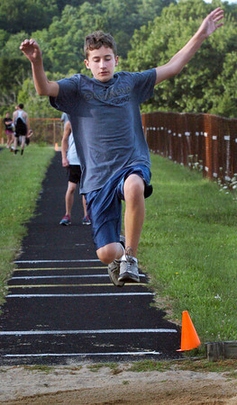 Amesbury: Marc Lundy of Merrimac in the long jump at the River Rival Grand Prix Track Series at Amesbury High School. Bryan Eaton/Staff Photo