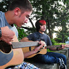 "Newburyport: Jon Gray, left, and Alex Pascal, both 16, of Newburyport, jam with some Beatles music on Newburyport's waterfront last night. The two are part of a large band that plays ""upbeat rock."" Bryan Eaton/Staff Photo"