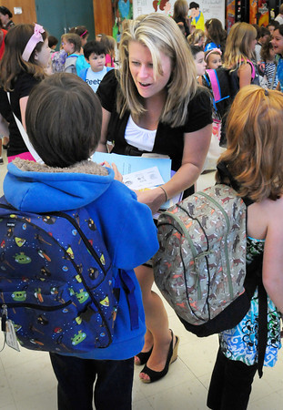 Merrimac: Second grade teacher Kristen Rowley greets her new students at the Sweetsir School in Merrimac yesterday. Pentucket District Schools started yesterday before the Labor Day Weekend. Bryan Eaton/Staff Photo
