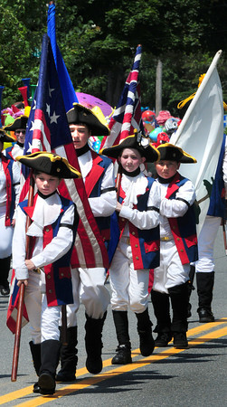 Newburyport: The Nutmeg Volunteers from Groton, Conn. march in the Yankee Homecoming Parade. Bryan Eaton/Staff Photo