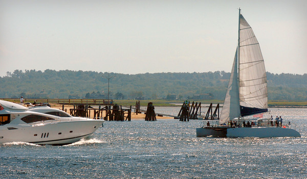 Newburyport: A catamaran heads out to sea past Plum Island Point under a full sail, though under mechanical power, as it fights a brish breeze coming from the east. Bryan Eaton/Staff Photo