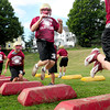 Newburyport: The Newburyport High School football team go through some warmup excercises Monday afternoon. Bryan Eaton/Staff Photo