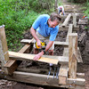 West Newbury: Bob Weatherall, in front, and other volunteers were working with the Essex County Trail Association over the past weekend to construct a large boardwalk on a conservation restriction in the Ocean Meadow senior housing subdivision off Chase Street in West Newbury. Bryan Eaton/Staff Photo