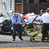 Salisbury: Salisbury Fire and AMR personnel move a pedestrian, who was allegedly struck by the vehicle in rear, to an ambulance in front of 125 North End Boulevard at Salisbury Beach yesterday afternoon. Bryan Eaton/Staff Photo