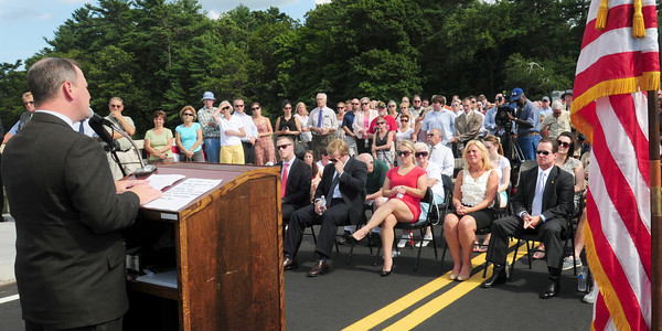 Amesbury: Sue and Steve Hines, right, listen to Lt. Governor Tim Murray at the dedication of the 1st Lt. Derek S. Hines Bridge yesterday afternoon. Bryan Eaton/Staff Photo