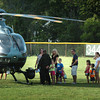 Amesbury: People line up to check out a Mass. State Police helicopter at Amesbury's Night Out on Tuesday. In addition the town's police, fire and DPW departments had vehicles to check out and also some old cars were on hand. Bryan Eaton/Staff Photo