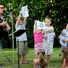 Salisbury: Nancy Sweeney gets youngsters into the act during her performance at Salisbury Public Library on Monday morning. The children were having a summer's end party for the Children's Reading Program their. Bryan Eaton/Staff Photo