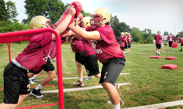 Newburyport: Newburyport High football players go through some drills on the first day of practice on Monday. Bryan Eaton/Staff Photo