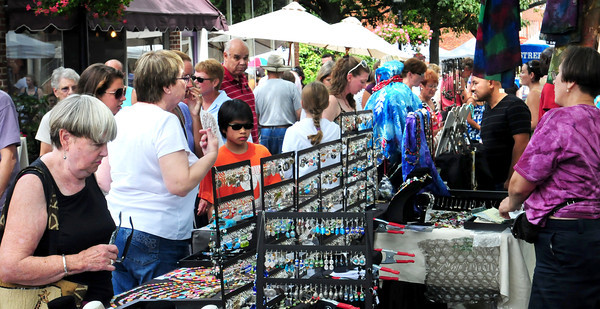 Newburyport: Yesterday's nice weather brought out many people to check out the Market Square Day Craft Show which ran up State Street, around Pleasant Street and, pictured, Inn Street. Bryan Eaton/Staff Photo