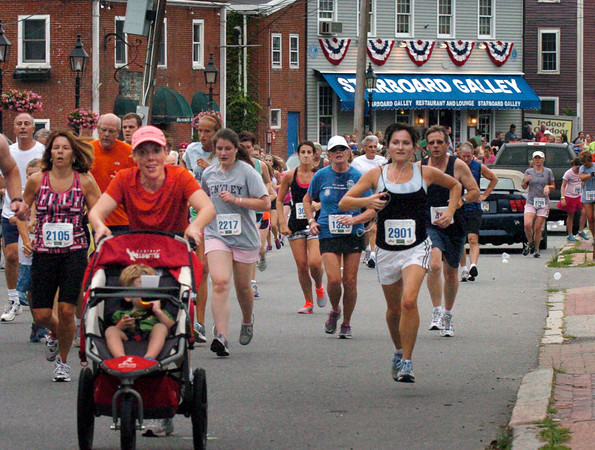 Newburyport: Runners from the Yankee Homecoming 5K race head along Water Street. Bryan Eaton/Staff Photo