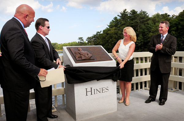 Amesbury: Rep. Michael Costello, left, and Lt. Governor Tim Murray, right, watch as Steve and Sue Hines unveil the plaque of their son, 1st Lt. Derek S. Hines at the dedication of the bridge named for the soldier who died in action. Bryan Eaton/Staff Photo