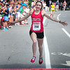 Newburyport: Female winner of the High Street Mile Kyle MacQueen of Boston. Bryan Eaton/Staff Photo