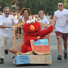 Newburyport: Elmo gets a ride with the team from Samarra Painting at the annual Yankee Homecoming Bed Race. Jim Vaiknoras/staff photo