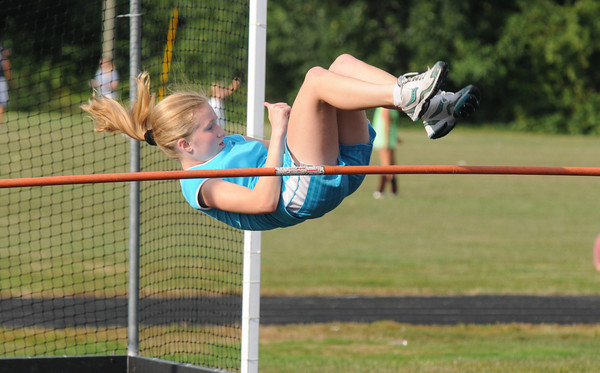 Newburyport: Katelyn Richardson just clears the bar in the high jump at the River Rival Grand Prix Track series at the Fuller Field in Newburyport Tuesday night. Jim Vaiknoras/staff photo