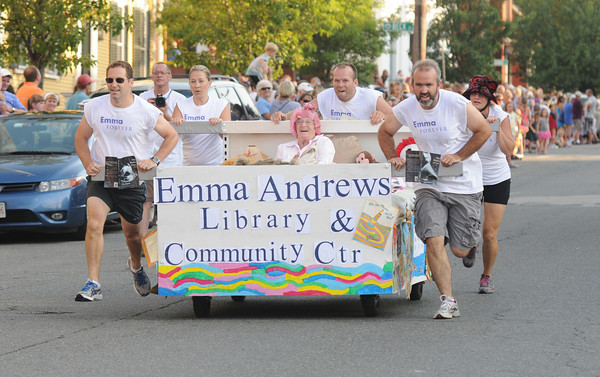 Newburyport: The Emma Andrews Library team sprints down Federal Street the annual Yankee Homecoming Bed Race. Jim Vaiknoras/staff photo