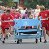 Newburyport: The Plum Island Life Guards at the annual Yankee Homecoming Bed Race. Jim Vaiknoras/staff photo