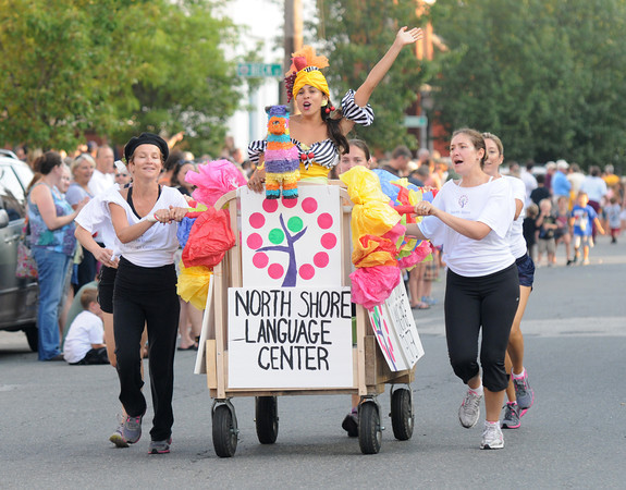 Newburyport: The North Shore Language Center finishes with an international flare at the annual Yankee Homecoming Bed Race. Jim Vaiknoras/staff photo