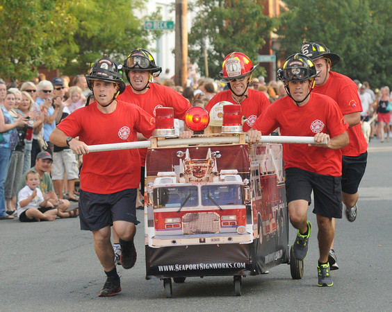 Newburyport: The team from the Newburyport Fire Department races to the finish at the annual Yankee Homecoming Bed Race. Jim Vaiknoras/staff photo