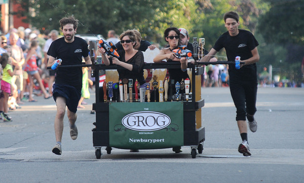 Newburyport:The Grog teams squirts the crowd at the annual Yankee Homecoming Bed Race. Jim Vaiknoras/staff photo